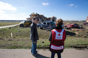 Hunter Keck speaking with a Red Cross volunteer about surviving the tornado.