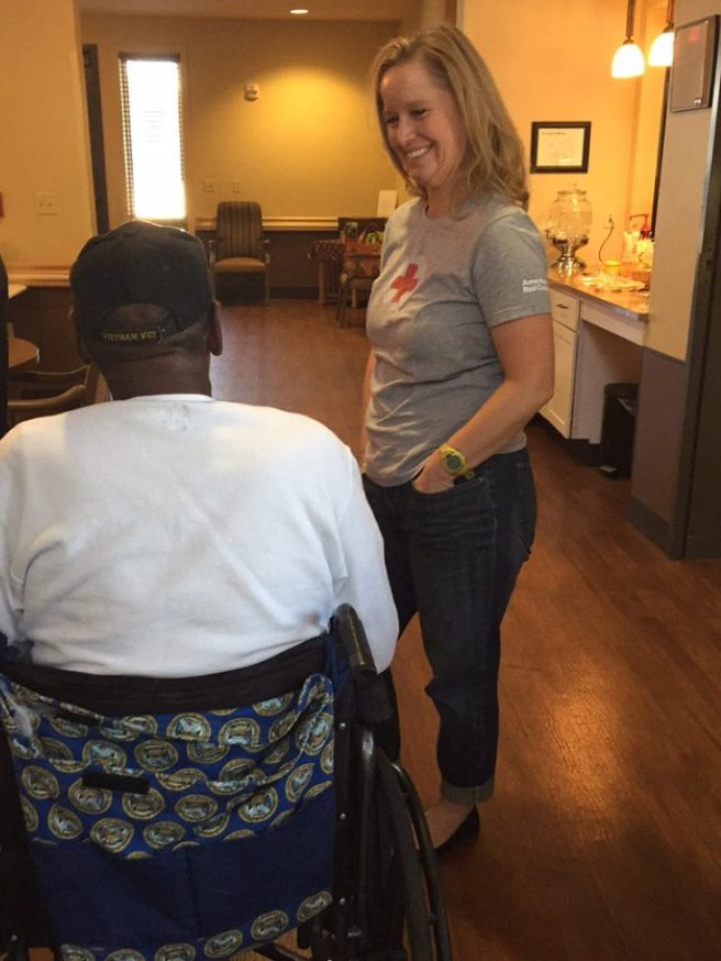 Kimberly Johnson talks with Mr. Franklin, a resident who loves to garden.