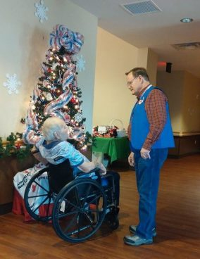 Roger talks with one of the veteran residents during the annual holiday party.