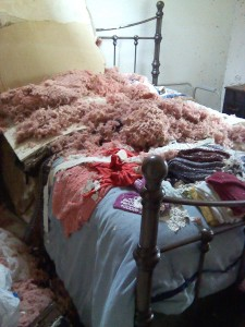 Judi's bed covered with debris after her apartment was destroyed.