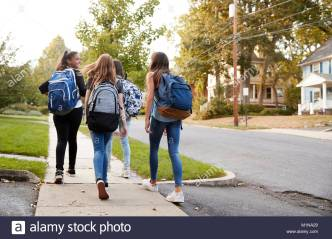 four-young-teen-girls-walking-to-school-together-back-view-M1NA29 - alarmy stock photos